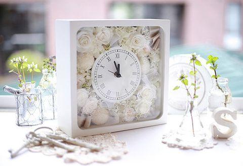 Botany, Clock, Home accessories, Still life photography, Interior design, Lavender, Twig, Measuring instrument, Wall clock, Quartz clock,