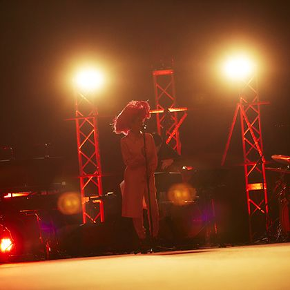 Stage, Light, Performance, Red, Lighting, Sky, Night, Performing arts, Lens flare, Event,