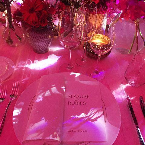 Pink, Magenta, Centrepiece, Lighting, Party favor, Stemware, Table, Wine glass, Champagne stemware, Tableware,