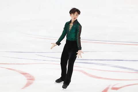 Ice skating, Skating, Figure skating, Recreation, Individual sports, Ice dancing, Figure skate, Winter sport, Leg, Suit,