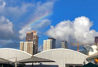 Sky, Cloud, Daytime, Rainbow, City, Architecture, Human settlement, Skyline, Meteorological phenomenon, Cumulus,