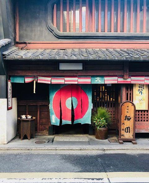 Red, Architecture, Facade, Building, Street, Door, Font, House, Street art, Window,