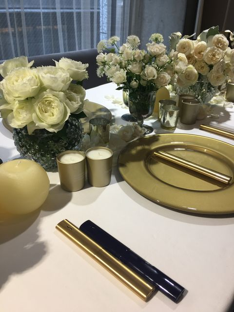 Yellow, Table, Centrepiece, Flower, Room, Interior design, Tableware, Floristry, Plant, Furniture,