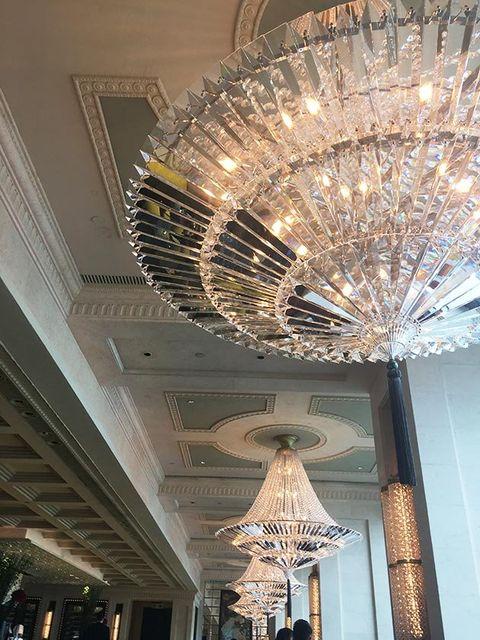 Ceiling, Light fixture, Lighting, Chandelier, Ceiling fixture, Lighting accessory, Architecture, Interior design, Lamp, Lobby,
