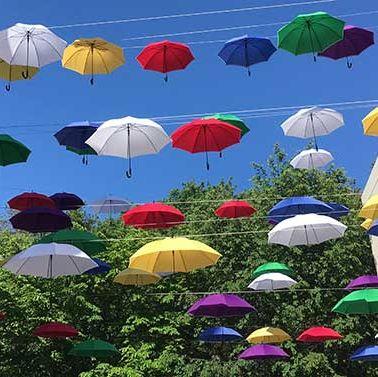 Umbrella, Sky, Fashion accessory, Organism, Cloud, Summer, Parachute, Plant, Leisure, Meteorological phenomenon,