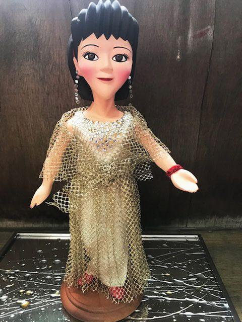 Doll, Toy, Head, Pink, Forehead, Dress, Cheek, Black hair, Figurine, Hand,