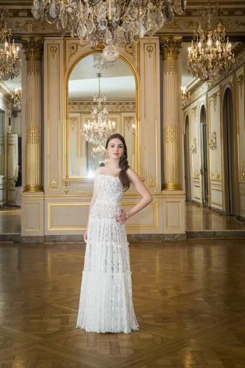 Clothing, Lighting, Floor, Flooring, Dress, Interior design, Light fixture, Formal wear, Ceiling, Hall,