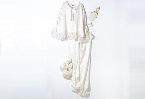 Sleeve, Textile, White, Pattern, Beige, Costume design, Embellishment, One-piece garment, Clothes hanger, Day dress,