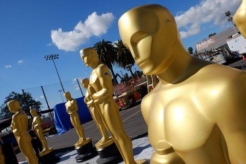 Yellow, Sculpture, Chest, Trunk, Metal, Statue, Abdomen, Brass, Nonbuilding structure, Barechested,