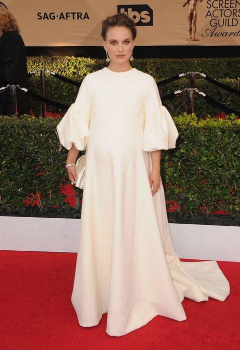 Red carpet, Carpet, Clothing, White, Dress, Flooring, Shoulder, Fashion, Premiere, Gown,