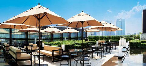 Umbrella, Resort, Property, Building, Shade, Patio, Real estate, Furniture, Fashion accessory, Leisure,