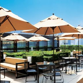 Umbrella, Resort, Property, Building, Shade, Patio, Real estate, Fashion accessory, Furniture, Leisure,
