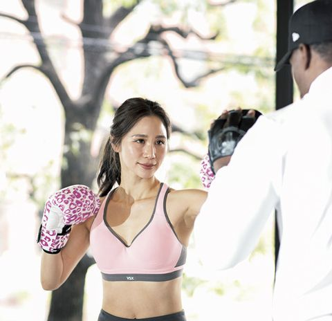 Sports bra, Undergarment, Brassiere, Undergarment, Arm, Shoulder, Physical fitness, Muscle, Boxing glove, Exercise,