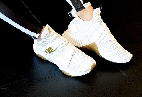 White, Footwear, Shoe, Yellow, Plimsoll shoe, Sock, Sneakers, Fashion accessory, Athletic shoe,