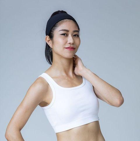 Brassiere, Clothing, Undergarment, Undergarment, Sports bra, Shoulder, Neck, Arm, Crop top, Outerwear,
