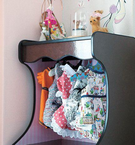 Diaper bag, Textile, Design, Room, Bag, Clothes hanger, Shelf, Visual arts, Pattern, Furniture,