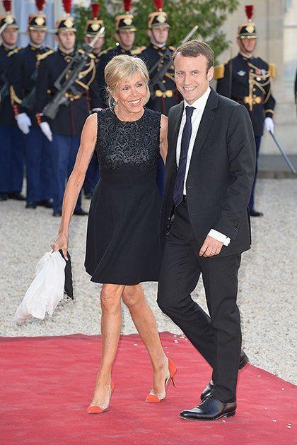 Red carpet, Carpet, Event, Flooring, Dress, Suit, Premiere, Formal wear, Smile,