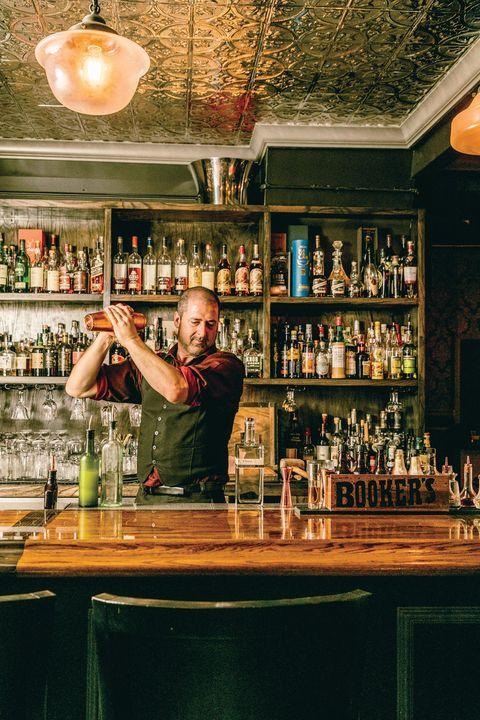Bartender, Bar, Alcohol, Liqueur, Distilled beverage, Barware, Drink, Building, Pub,