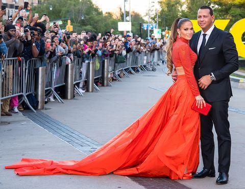 Gown, Dress, Red, Red carpet, Event, Orange, Carpet, Formal wear, Shoulder, Prom,