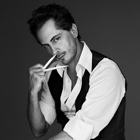 White, Smoking, Suit, Nose, Chin, Formal wear, Black-and-white, Mouth, Tuxedo, Lip,