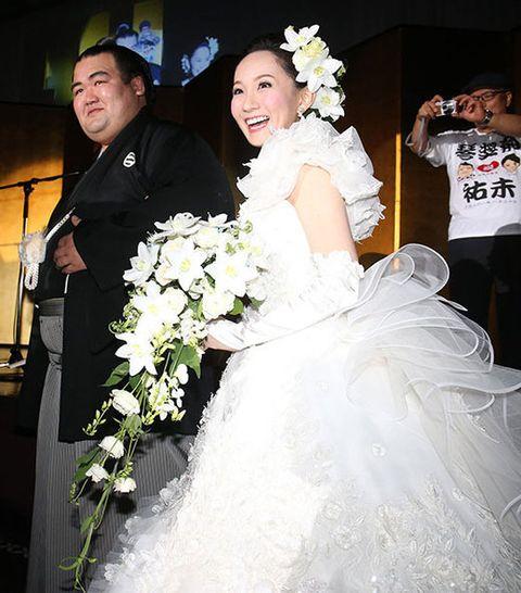 Clothing, Petal, Bridal clothing, Sleeve, Trousers, Bouquet, Dress, Wedding dress, Photograph, Bride,