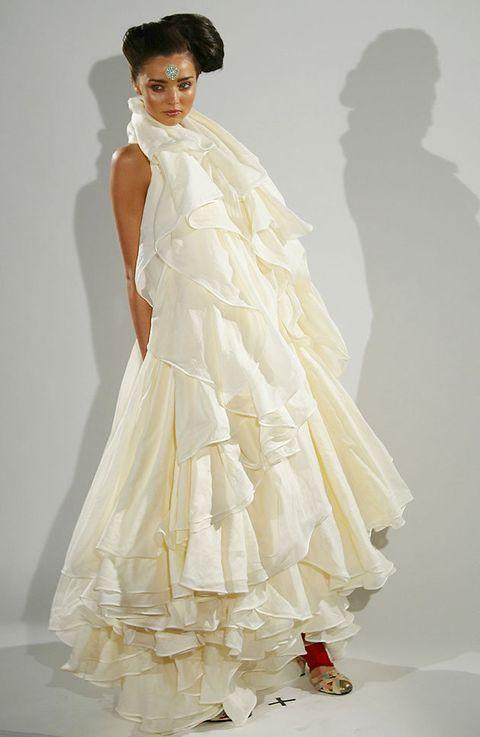 Gown, Clothing, Dress, Wedding dress, White, Fashion model, Shoulder, Bridal clothing, Bridal party dress, Fashion,