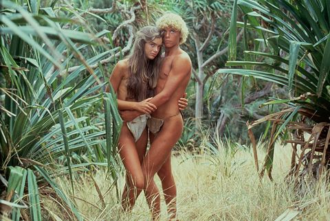 People in nature, Nature, Blond, Jungle, Grass family, Grass, Plant, Tree, Palm tree, Muscle,