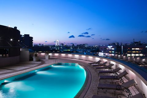 Blue, Swimming pool, Sky, Night, Property, Architecture, Metropolitan area, Lighting, Building, Real estate,
