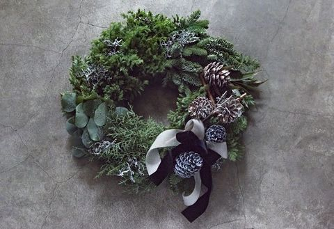 Wreath, Wall, Plant, Footwear, Botany, Flower, Grass, Herb, Floral design, Shoe,