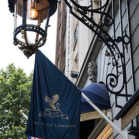 Iron, Pole, Flag, Electric blue, Metal, Street light, Banner, Electrical supply,