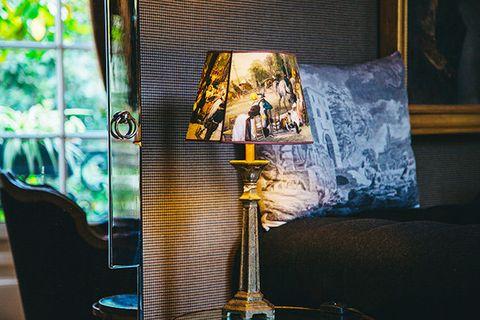 Yellow, Lighting, Lampshade, Lighting accessory, Tree, Glass, Room, Architecture, Art, Light fixture,