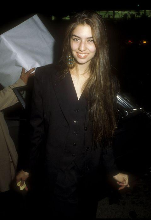 Suit, Formal wear, Long hair, Outerwear, Tuxedo, Darkness, Smile, Night, Blazer, Black hair,