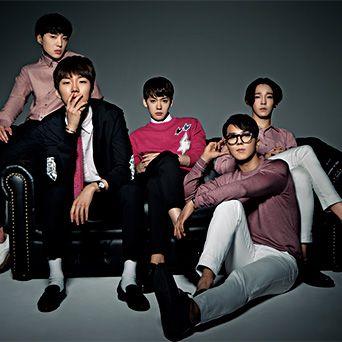 Footwear, Leg, Social group, Sitting, Black hair, Fashion, Youth, Cool, Knee, Comfort,