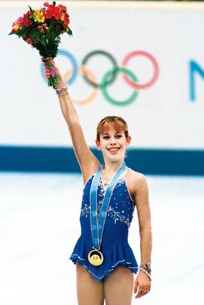 Individual sports, Recreation, Majorette (dancer), Sports, Maillot, One-piece swimsuit, Plant, Electric blue, Flower, Ice skating,