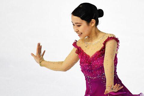 Ice skating, Recreation, Dancer, Dress, Gesture, Figure skating, Hand, Skating, Formal wear,