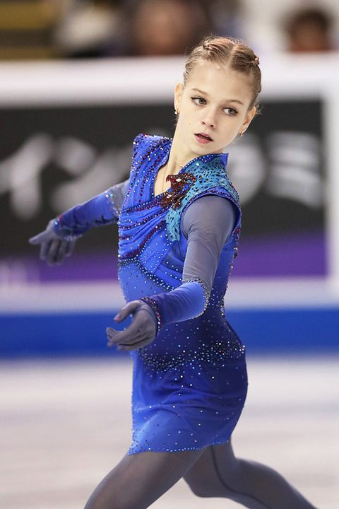Ice skating, Figure skating, Figure skate, Skating, Blue, Recreation, Leotard, Ice dancing, Sports, Individual sports,