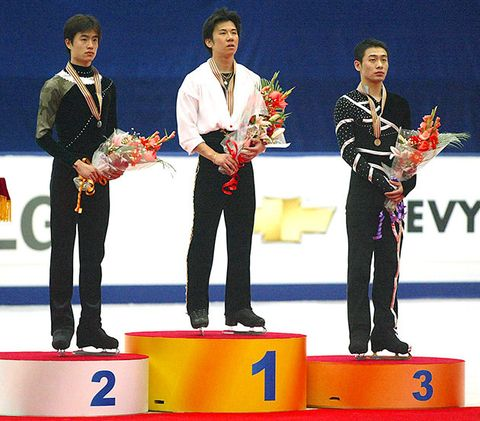 Podium, Medal, Award, Gold medal, Stage equipment, Trophy, Silver medal, Technology, Electronic device, Championship,