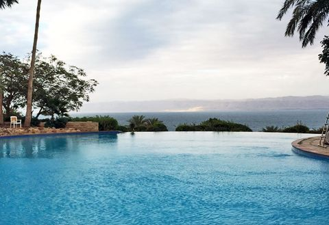 Swimming pool, Water, Sky, Water resources, Natural landscape, Property, Resort, Sea, Vacation, Tree,