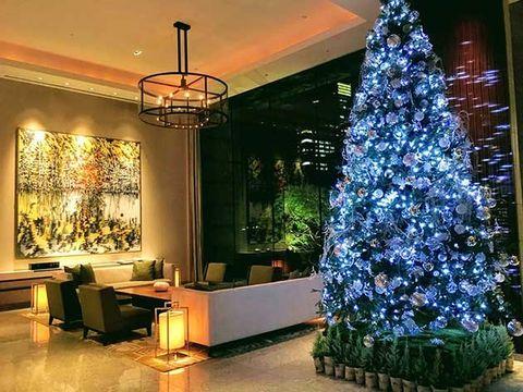Christmas tree, Christmas decoration, Tree, Christmas, Interior design, Room, Home, Lighting, Living room, Christmas lights,