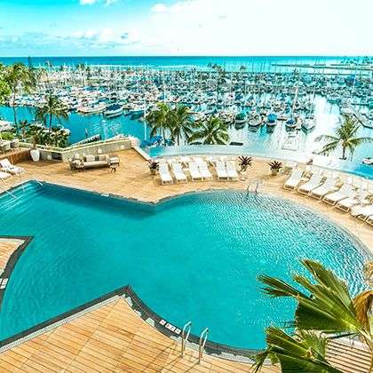 Swimming pool, Resort, Property, Vacation, Azure, Resort town, Caribbean, Real estate, Seaside resort, Building,