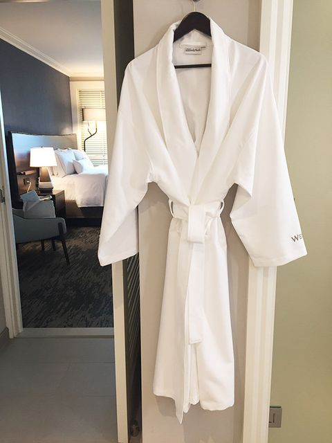 Clothing, White, Robe, Outerwear, Coat, Wrap, Dress, Sleeve, Room, Beige,