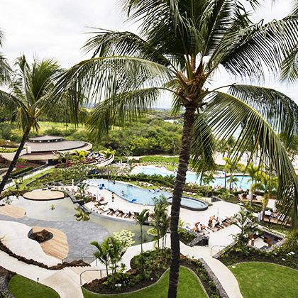 Resort, Palm tree, Tree, Vacation, Arecales, Attalea speciosa, Tropics, Landscape, Real estate, Plant,