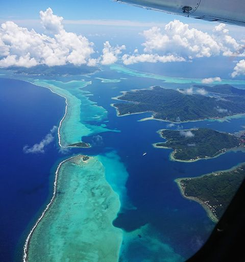 Sky, Aerial photography, Water resources, Coastal and oceanic landforms, Natural landscape, Air travel, Island, Inlet, Bird's-eye view, Water,