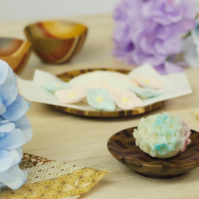 Petal, Flower, Baking, Teacup, Hydrangea, Food, Party favor, Fashion accessory, Dessert, Tableware,