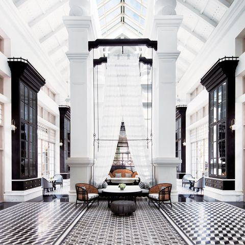 White, Building, Architecture, Column, Room, Lobby, Interior design, Symmetry, Furniture, Ceiling,
