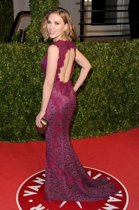 Red carpet, Carpet, Dress, Clothing, Gown, Flooring, Shoulder, Hairstyle, Fashion model, Fashion,
