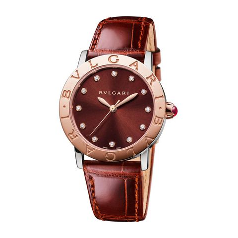 Product, Analog watch, Brown, Watch, Glass, Red, Fashion accessory, Watch accessory, Amber, Orange,