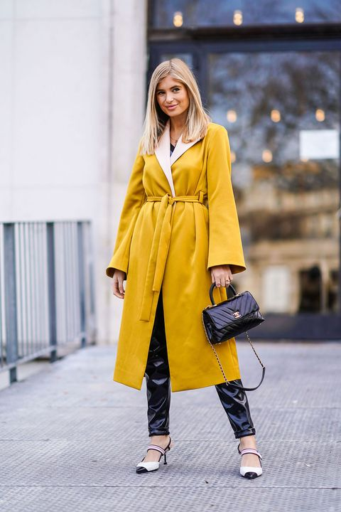 Clothing, Street fashion, Yellow, Fashion, Overcoat, Trench coat, Coat, Outerwear, Fashion model, Shoulder,