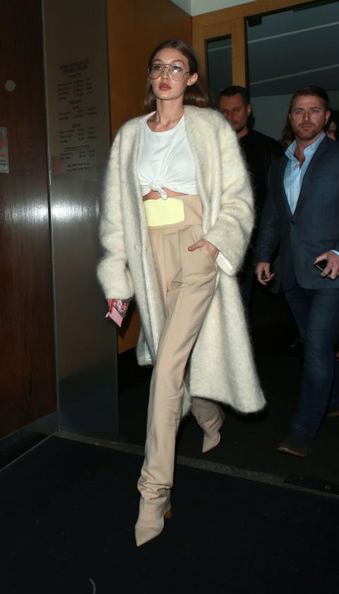 Footwear, Leg, Coat, Trousers, Human body, Shoe, Shirt, Outerwear, Standing, Style,