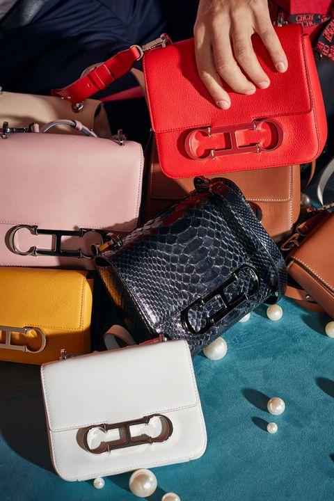Bag, Hand, Fashion, Nail, Fashion accessory, Material property, Baggage, Finger, Handbag, Leather,